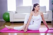 image of yoga mat  - Fit woman doing yoga on mat at home in the living room - JPG