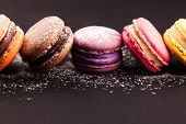 stock photo of sugar  - Row of french colorful macaroons with powdered sugar - JPG