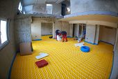 stock photo of convection  - group of workera installing underfloor heating and colling in modern home - JPG