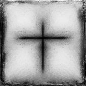 picture of leak  - abstract black cross silhouette on  grunge background with heavy grain and light leak - JPG