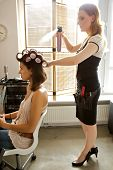 pic of hairspray  - Female hairdresser spraying hairspray in customer - JPG