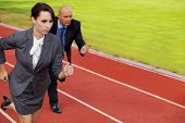 pic of race track  - Businessman and woman on running on race track - JPG