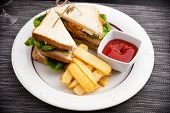 stock photo of french fries  - Sandwich with fried eggs - JPG