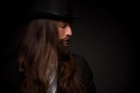 foto of long beard  - He is a rock star and he can play guitar - JPG