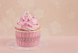 picture of sugarpaste  - Pink cupcakes on a beige background - JPG