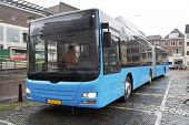 blue articulated bus