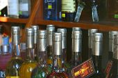stock photo of liquor bottle  - bottles on shelf - JPG