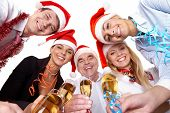foto of christmas party  - Portrait of smart colleagues with flutes of champagne wishing you Merry Christmas - JPG