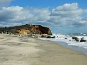 picture of martha  - Rocks and a cliff on the beach in Martha - JPG