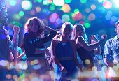 party, holidays, celebration, nightlife and people concept - group of happy friends dancing in night poster