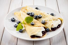 stock photo of crepes  - Crepes with blueberries and cream - JPG