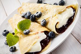 picture of crepes  - Crepes with blueberries and cream - JPG