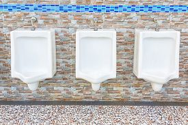 pic of urinate  - Closeup of three white urinals in men - JPG