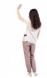 foto of waving hands  - Back view of curly woman welcomes - JPG