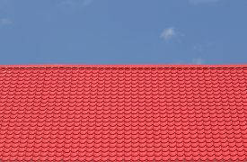 foto of red roof  - texture of red roof with blue sky - JPG