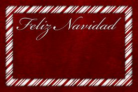 stock photo of candy cane border  - A Feliz Navidad card A Candy Cane border with words Feliz Navidad over red plush background with copy - JPG