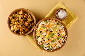 stock photo of rice  - The Indian Pulav vegetables and The rice is browned in oil and then mixed with vegetables nuts - JPG