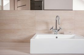 foto of tapping  - Close up of elegant white washbasin with simple tap - JPG