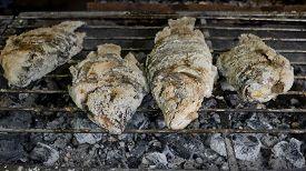 image of crust  - Closeup Thai Food Salt Crusted Grilled Fish - JPG