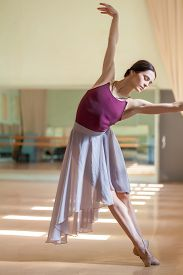 image of ballet barre  - The classic ballet dancer posing at ballet barre on a rehearsal room background - JPG
