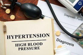 picture of hypertensive  - High blood pressure   hypertension written on a book - JPG
