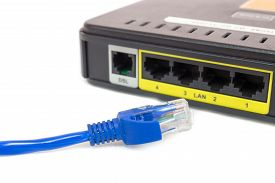 pic of cat5  - Close up LAN UTP RJ45 Cat5e In front of ADSL Router network switch