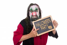 foto of ugly  - ugly mad clown holding a slate text Halloween party isolated on white concept invitation - JPG