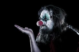 picture of ugly  - horror clown with ugly face looking to copyspace black background concept creepy theme party or halloween  - JPG