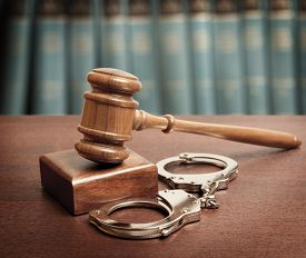 pic of handcuff  - Gavel and handcuffs on wooden background - JPG