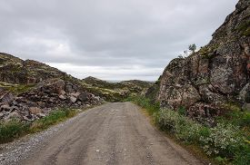 stock photo of murmansk  - Road in rocky tundra of the Rybachy peninsula near Murmansk Russia - JPG