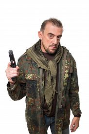foto of terrorist  - Male terrorist in a military jacket with a gun in his hand - JPG