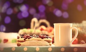 foto of eclairs  - Eclair and cup of coffee on wooden table - JPG
