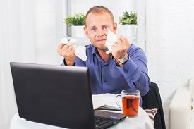 stock photo of panic  - Young businessman working in the office very concerned a panic crumpled paper - JPG