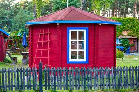foto of outhouse  - Red old vintage outhouse with fence - JPG