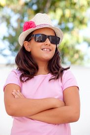 picture of ten years old  - Nice child girl ten year old with a hat on the street - JPG