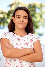 foto of ten years old  - Nice child girl ten year old smiling on the street - JPG