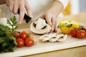 picture of kitchen utensils  - female chopping food ingredients - JPG