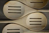 Close up of spatulas arranged side by side on table poster