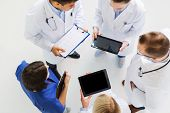 medicine, healthcare, people and cardiology concept - group of doctors with cardiogram and tablet pc poster