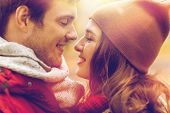 love, relationships, season and people concept - close up of happy young couple kissing outdoors poster