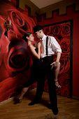 couple in love dancing Latino dance at the nightclub