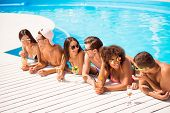 Six Friendly Multi Ethnic Hot Teens In Diverse Swim Wear And Spectacles Are Chatting, Standing In Th poster