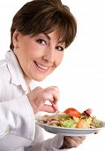mature woman on a diet eating salad