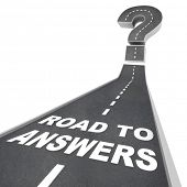 The words Road to Answers in white letters on a street leading to a question mark, symbolizing the n