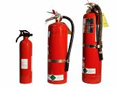 stock photo of fire extinguishers  - three fire extinguishers - JPG