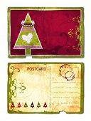 Grunge postcard front and back with Christmas tree and heart swirl design and rich paper texture. Clipping path included