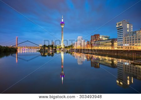 poster of Dusseldorf, Germany. Cityscape Image Of Düsseldorf, Germany With The Media Harbour And Reflection Of