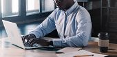 Unreconizable Banner Of Young African American Business Man Working, Using Laptop At Office While Si poster