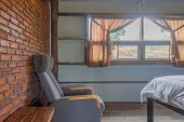 Arm Chair In Country Loft Interior Design Room. Interior Design Room Include Windows And Bed And Cur poster