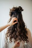 Closeup Of Female Hands Of Hairdresser Or Coiffeur Makes Hairstyle poster